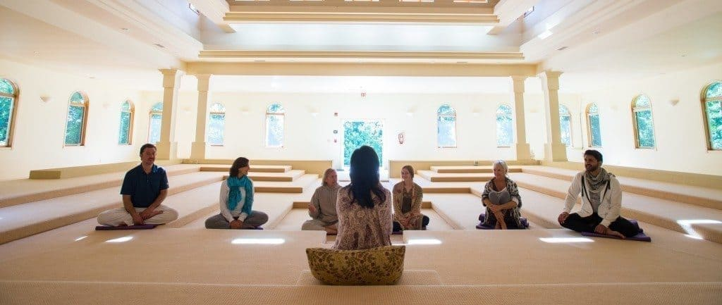 A calming program at the yoga & meditation retreat center meditation hall on the mountain