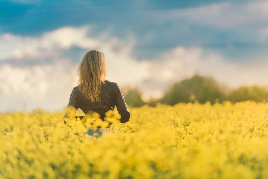woman in yellow field at sunset resize