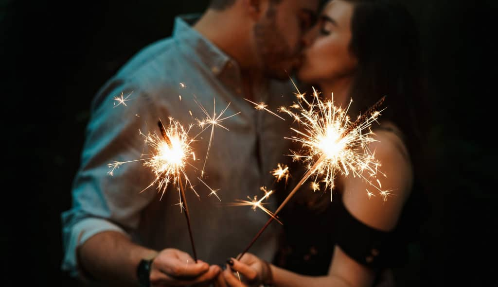 hero image couples with firework sparklers