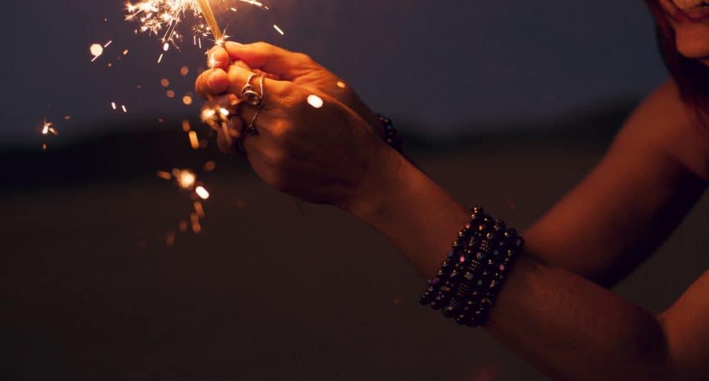 holding fireworks