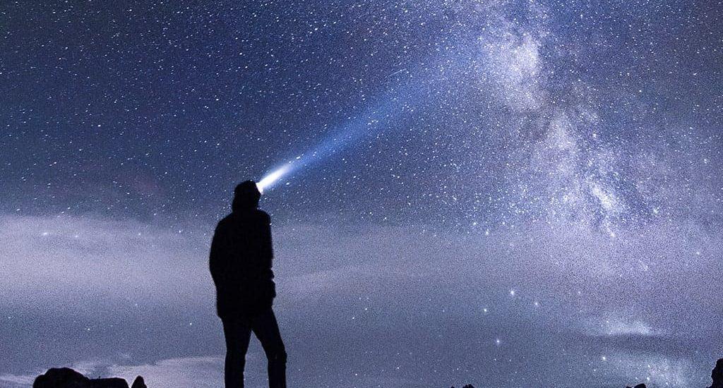 man looking at night sky